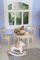 Bildno.: 11090091<br/><b>Feature: 11090073 - It's a Doll's World</b><br/>Teatime in Stepahnie Rathjens' dollhouse<br />living4media / Bannick, Sonja