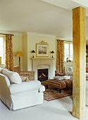 Traditional, country house living room with cosy open fire