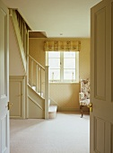 View through open double doors into bright stairwell of country house