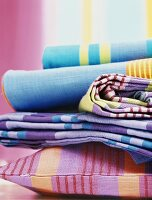 Colourful fabrics and cushions