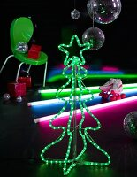 A light-chain Christmas tree and colourful glow stick in a black-painted room