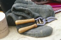 Pair of secateurs, woollen socks