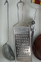 Cookware hanging from hooks