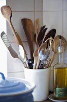 Kitchen utensils in ceramic pot