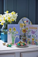 Easter cards and chocolate Easter eggs on a table