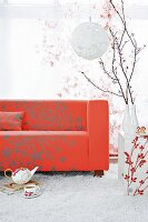 Red sofa on white flokati rug