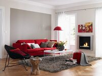 Living room in red and grey with sofa and fireplace