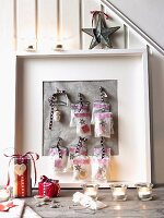 Small advent calendar bags in a picture frame