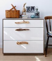 A modern chest of drawers with driftwood handles