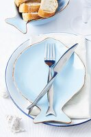 A place setting with fish-shaped crockery and cutlery