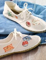 Stamps stuck on white fabric shoes