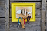 Hand-crafted key rack with fish skeleton made from flotsam