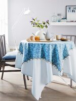 A homemade, two-in-one tablecloth on a round dining table