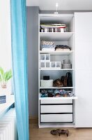An organiser system with drawers, shoe boxes and a divider drawer in a bedroom