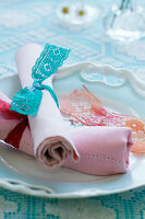 Napkins tied with lace ribbons
