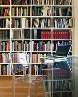 Acrylic glass furniture in front of bookcase