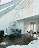 Open-plan living space with gallery and spiral staircase in converted loft