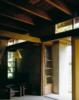 House with exposed wooden beam ceiling and concrete walls
