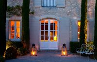 Floor lanterns flanking door of Provençal stone house