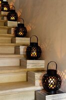 Black-painted bamboo lanterns lighting a staircase