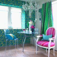Hand-crafted glass chandelier and Louis XVI chair bring Rococo air to room with turquoise wallpaper