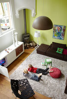 Children on a flokati rug in a modern living room