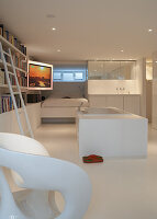 A free-standing bathtub in a modern bedroom