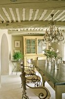 Provençal dining room with wrought iron chairs