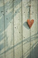 Heart hanging on a wooden door