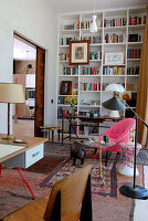 Library with tall bookcases and fifties-style desk