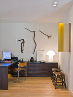 Elegant office furniture and wooden carvings on wall