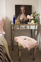 Baroque portrait of woman, perfume flagons and cut roses on antique, mirrored console table with matching stool