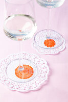 Doilies with stamp motifs used as coasters
