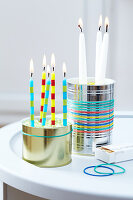 Original candle holders made form tin cans and coloured rubber bands