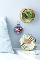 Original DIY clocks made from tin cans featuring coloured hands