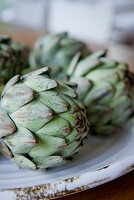 Artichokes on vintage plate