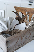 Linen napkins and antlers in vintage wooden crate