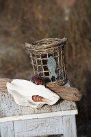Seashells next to vintage wicker basket on weathered stool