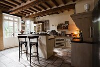 Rustic kitchen with island unit and bar stools