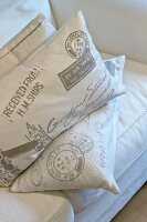 Cushions with lettering on covers on white sofa