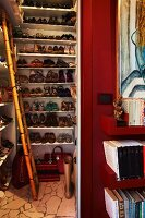 Ladies' shoes on floor-to-ceiling white shelving in niche
