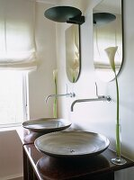 Modern washstand with counter-top wash basins and wall-mounted taps