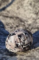 Artistically decorated egg on stone surface