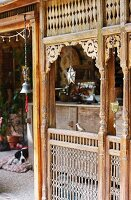 Old, Oriental, carved wooden panel enclosing veranda