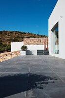 Slate tile patio along modern home