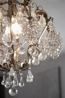 Romantic vintage chandelier with glass baubles and teardrops