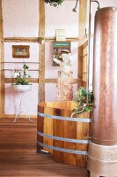 Bathroom with free-standing wooden bathtub