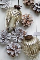 Silver Christmas decorations and pinecones