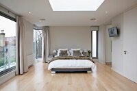 Elegant designer style bedroom with floor to ceiling windows