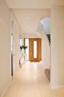 Light and bright, modern stairway and wooden front door